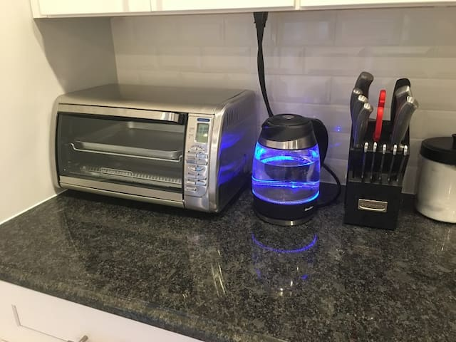 Toaster oven, tea kettle, and other appliances.