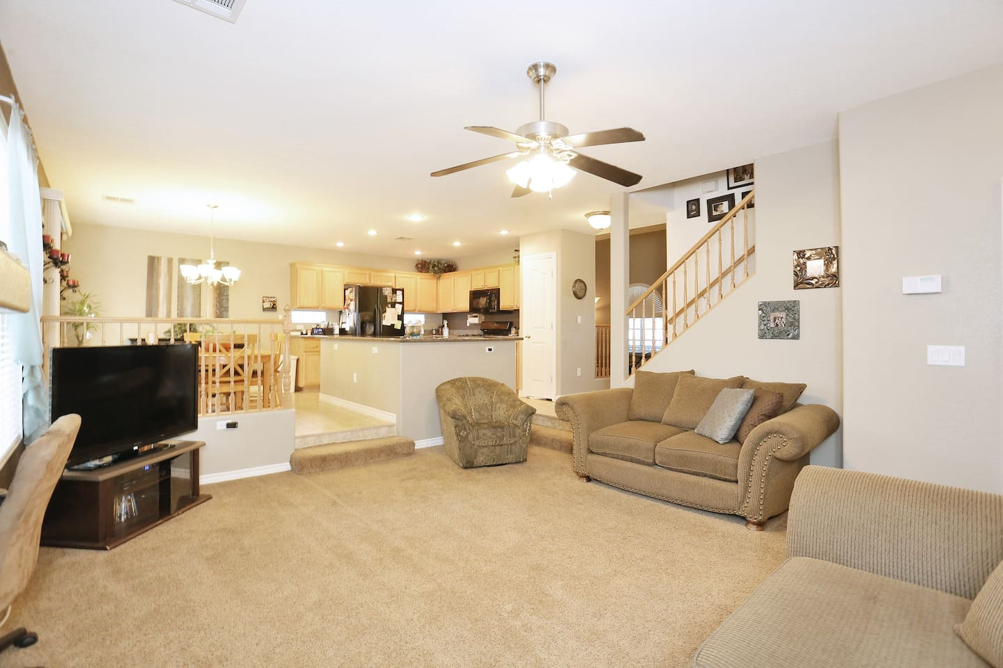 Combined family room, kitchen, and dining area.