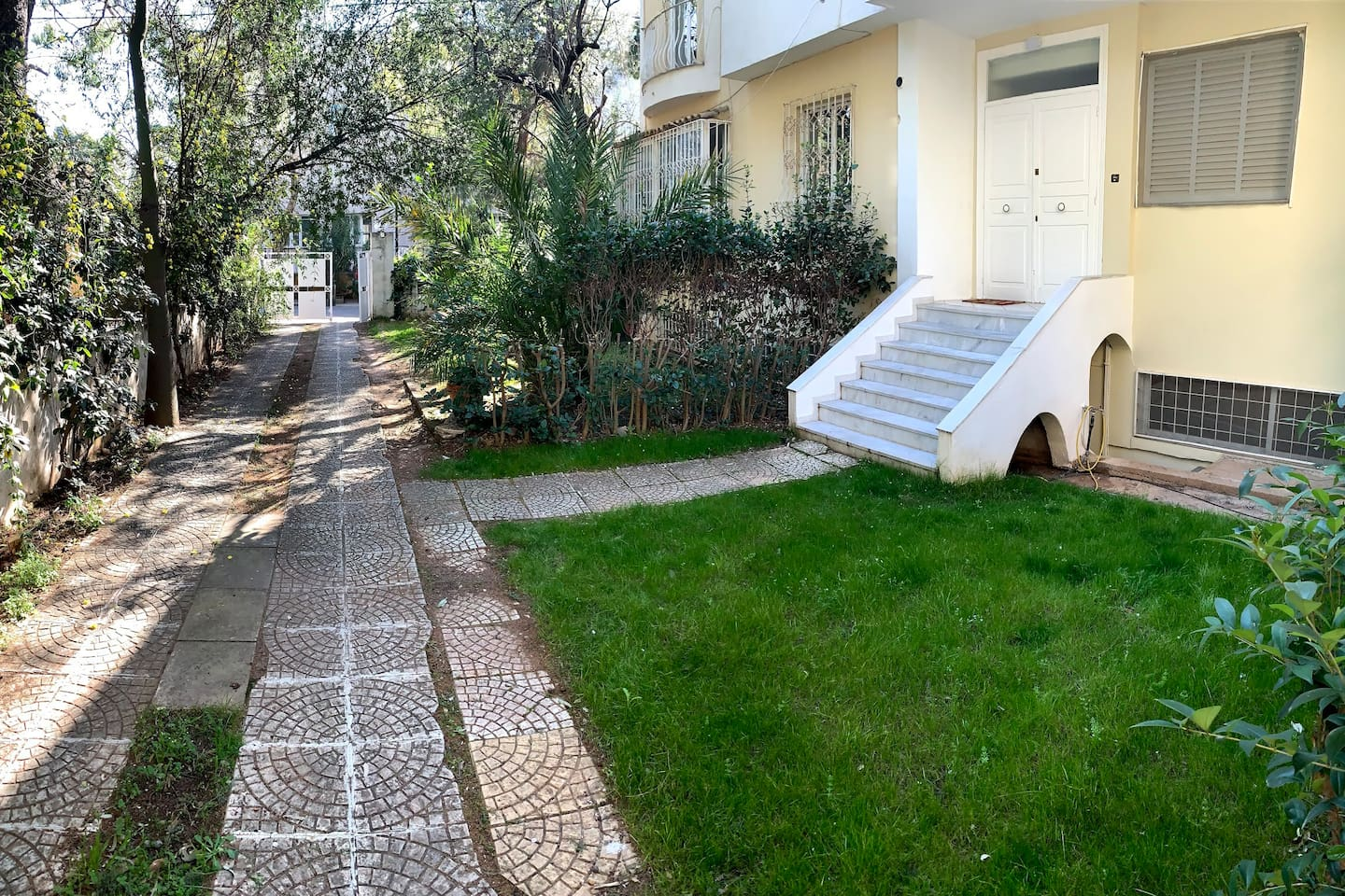 The front door with private garden and parking space.