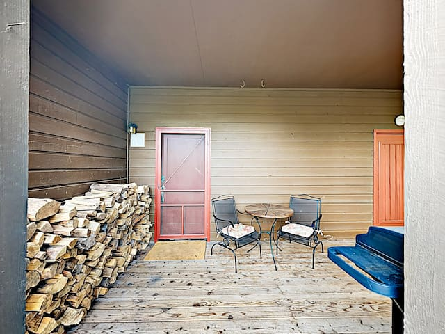 Thoughtful touches include firewood on the front porch.