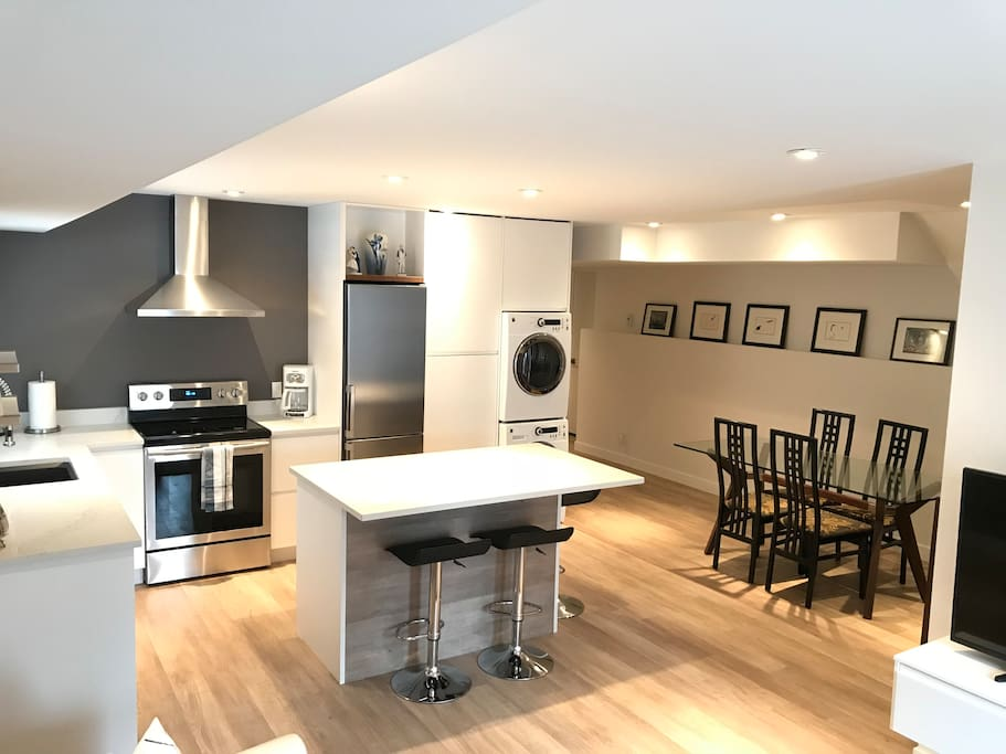 Complete kitchen and eating bar with seating for 3