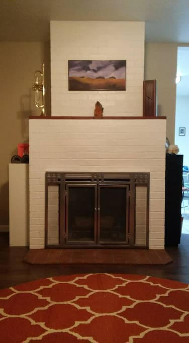 Living room fireplace available for guests enjoyment.