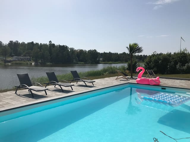 Lake villa with outdoor heated pool and jacuzzi