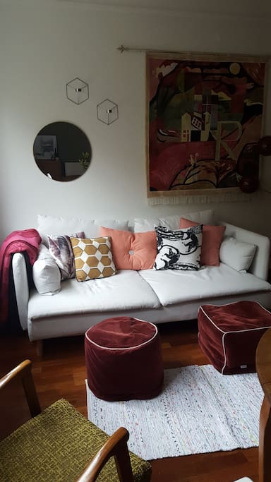 The living room has a comfortable sofa and sitting arrangements, TV with cable, a dining area and a fireplace.