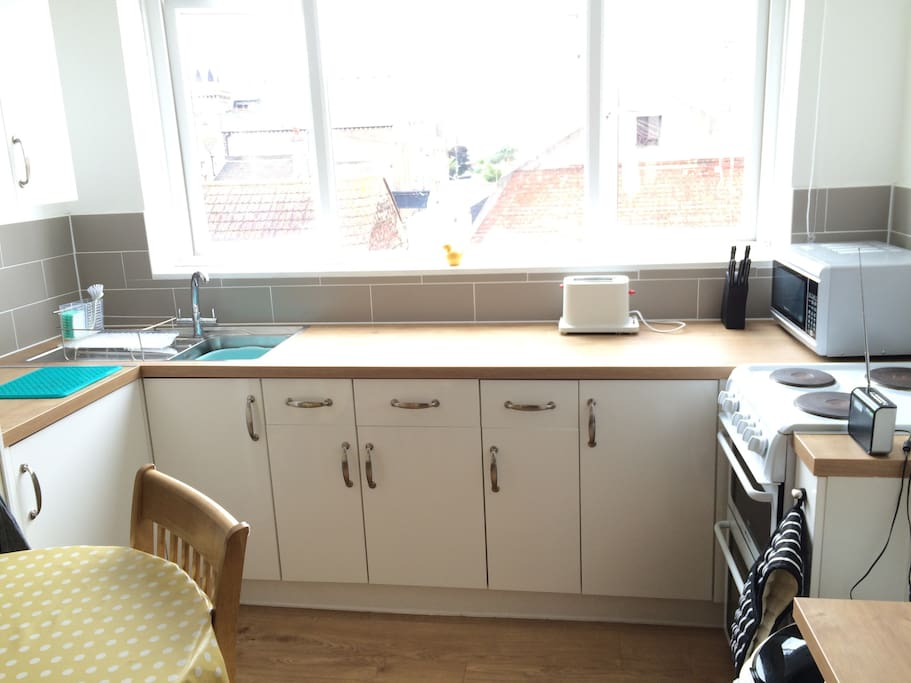 The kitchen is complete with pots and pans, cutlery and crockery, plus kitchen towel and cleaning supplies.