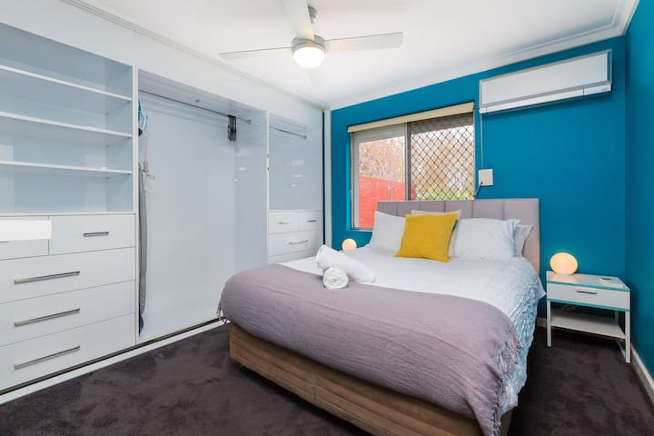 The main bedroom. Queen bed. Plenty of storage space for your belongings. This bedroom also has a shutter screen which can be used to block out all sunshine!