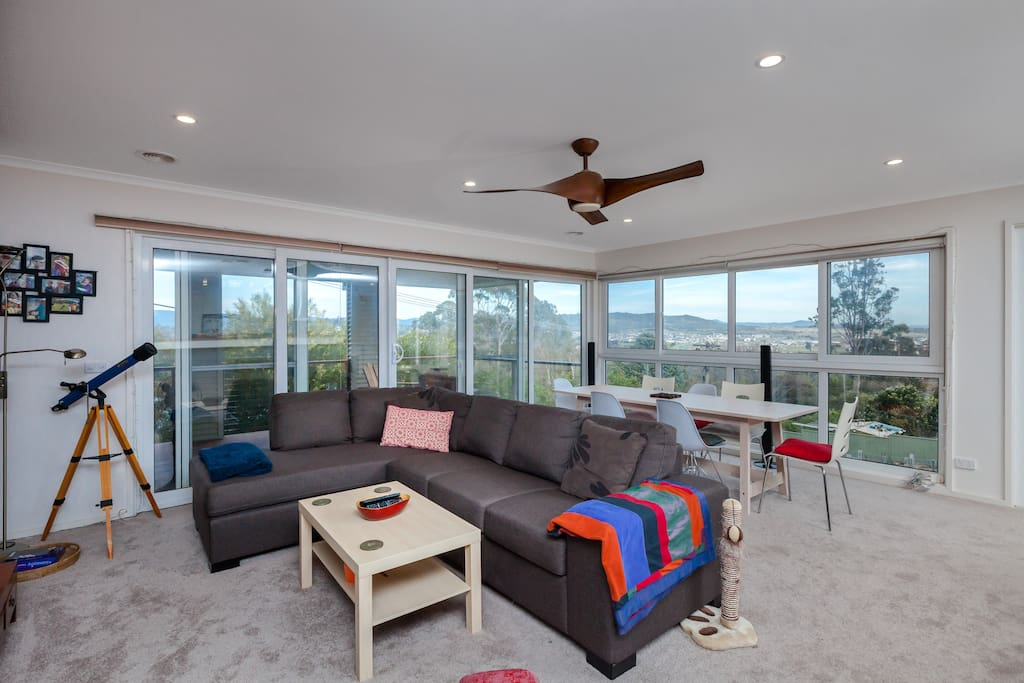 Comfortable lounge and dining overlooking Brindabella Mountains