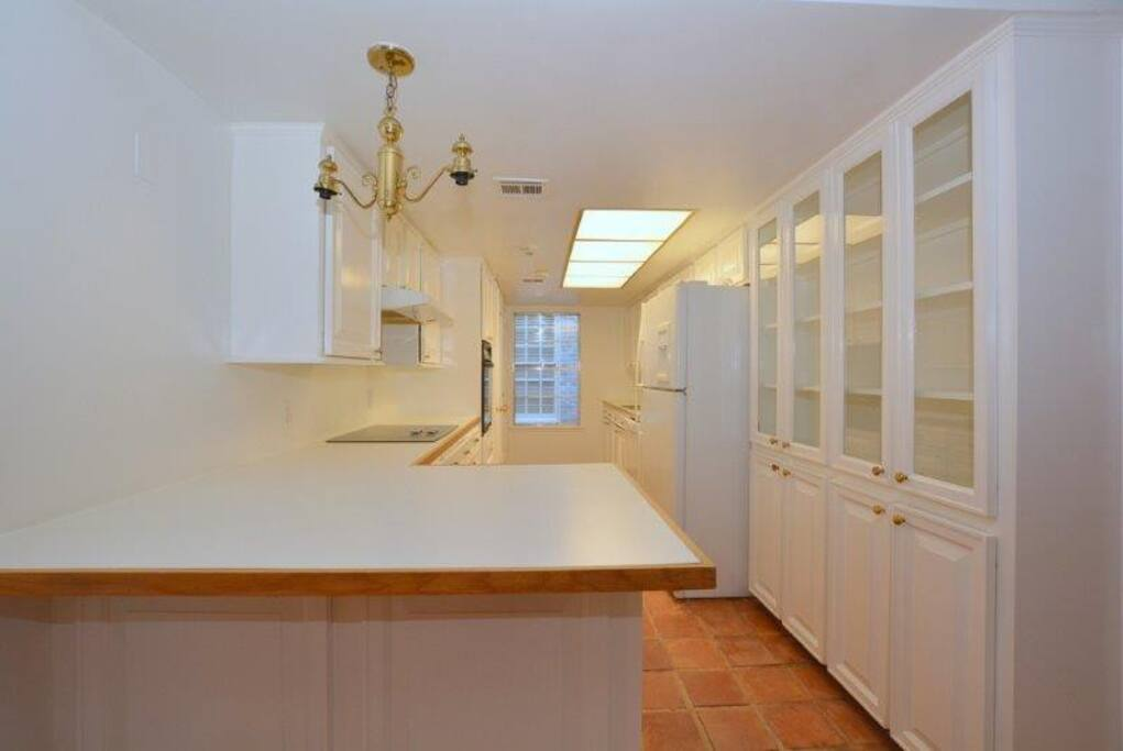 breakfast bar and entrance to kitchen