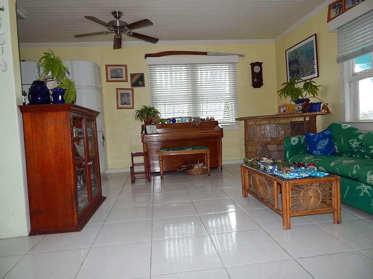 Enjoy your own bright tropical living room.  Your hosts have their own living area.