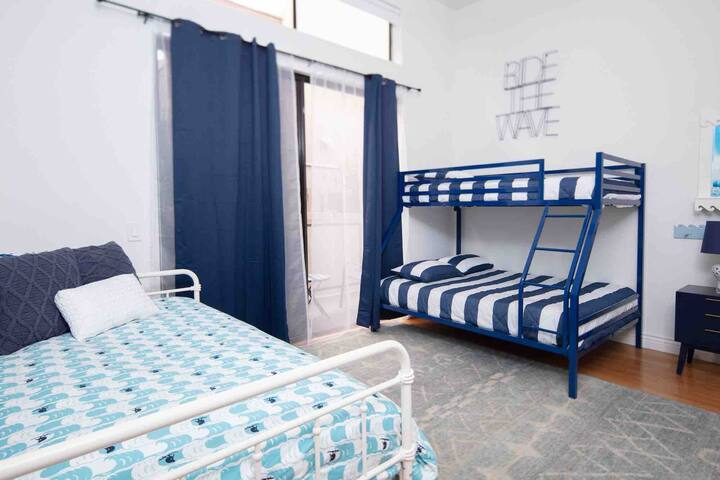 Twin over full bunk bed and twin trundle bed can sleep 5.