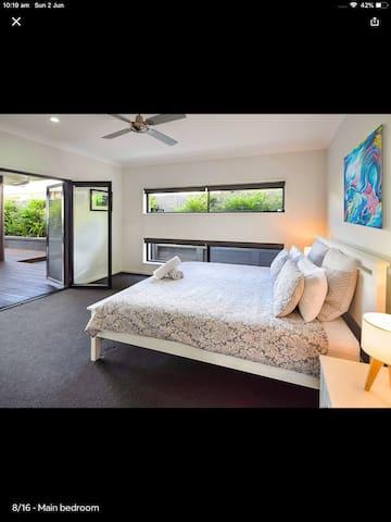 Bedroom doors lead out to pool