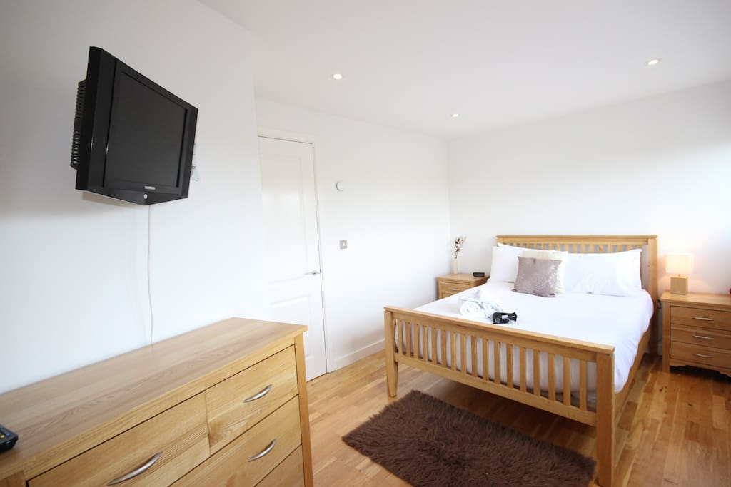 Comfortable bedroom with TV and storage