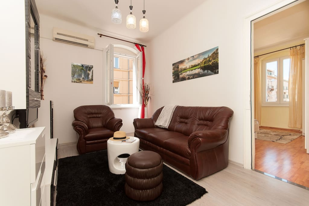 Relaxing living room with premium leather furniture and lots of light.