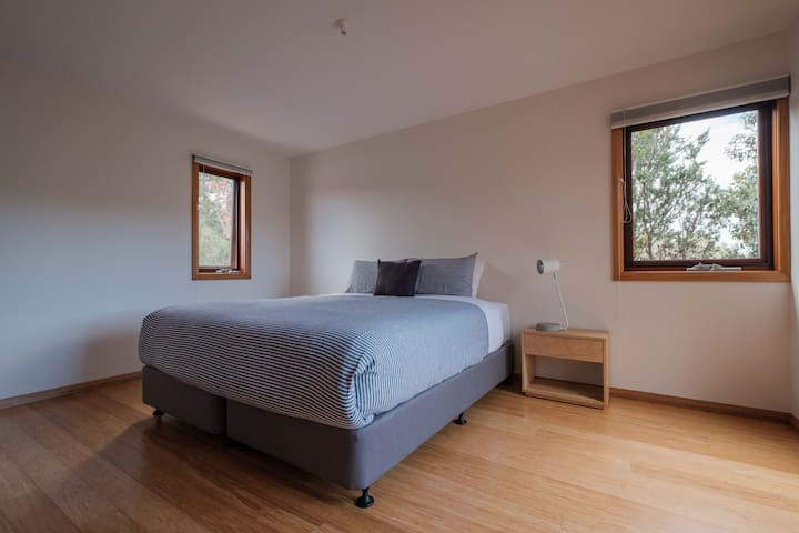 Two spacious bedrooms. One with a king bed & one zip together king (can be 2 singles)