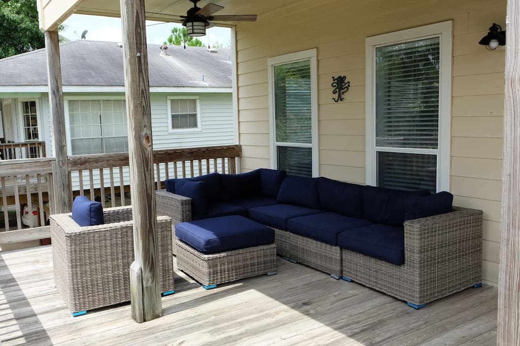 Large patio with luxury furniture to relax and enjoy the breeze from Clear Lake only one block away.