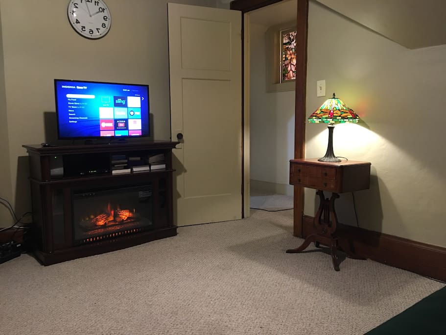 The entertainment center has a built-in fireplace heater.