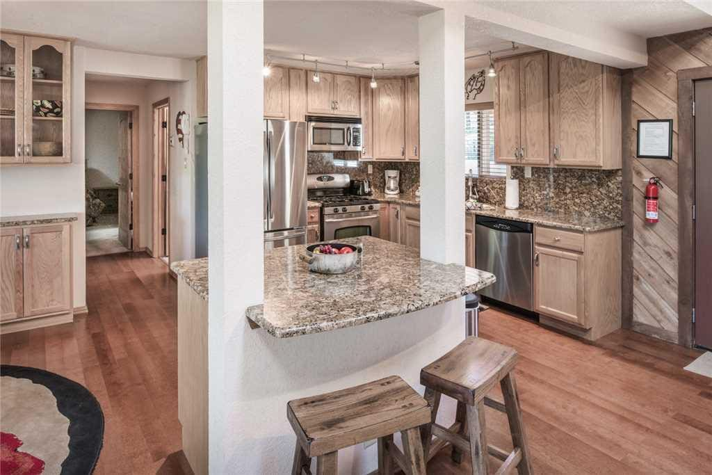 Kitchen Island - An open floor plan allows you and your party to gather and have a good time while preparing delicious meals.