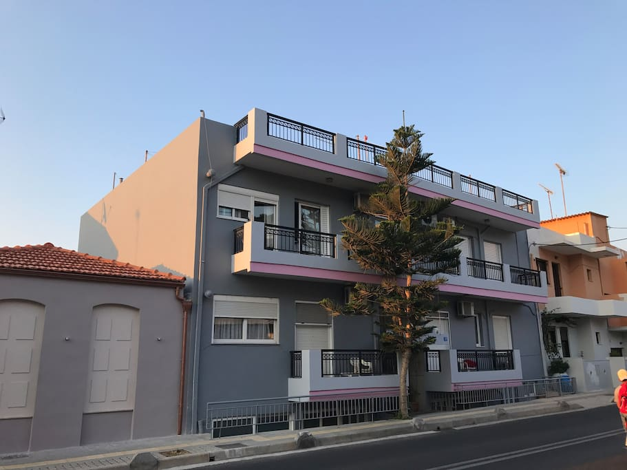 This is the street side of the building. Apt10 has a street door which is lower than the street lever right under the lower-right balcony. Street level is higher than the garden and sea levels.
