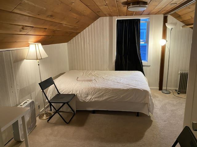 Upstairs queen mattress bedroom