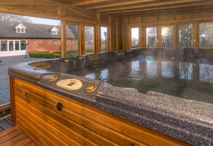 12 foot swim spa in a purpose built garden house for use all year round