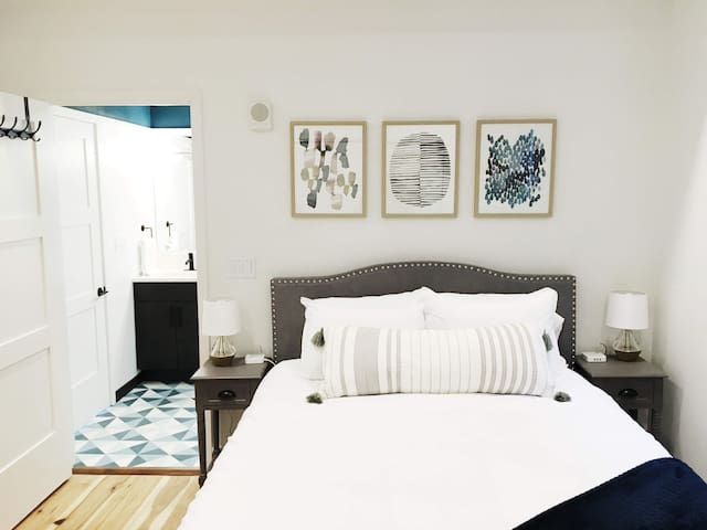 The Bedroom. Comfy queen size bed. Charging stations on both nightstands.