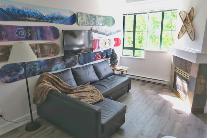 "Amazing snowboard wall with  42"" SmartTV mounted and ready to watch your favorite Netflix shows. Some of the snowboards are painted by a talented local artist."
