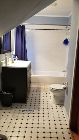 Shared large upstairs bathroom. There is also a 1/2 bath located downstairs