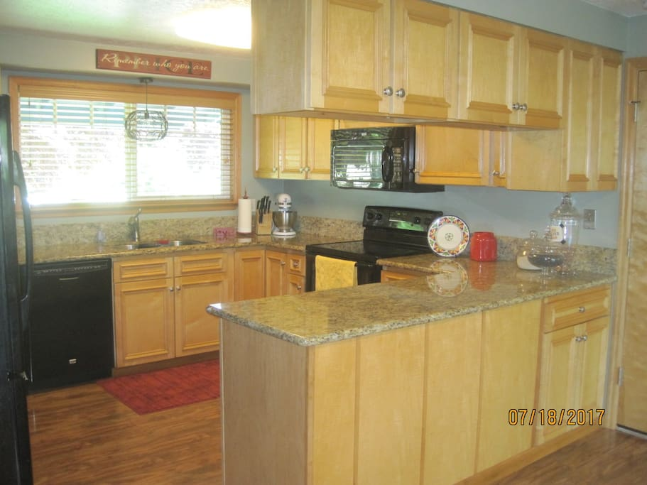 Large open kitchen with everything to cook some nice meals
