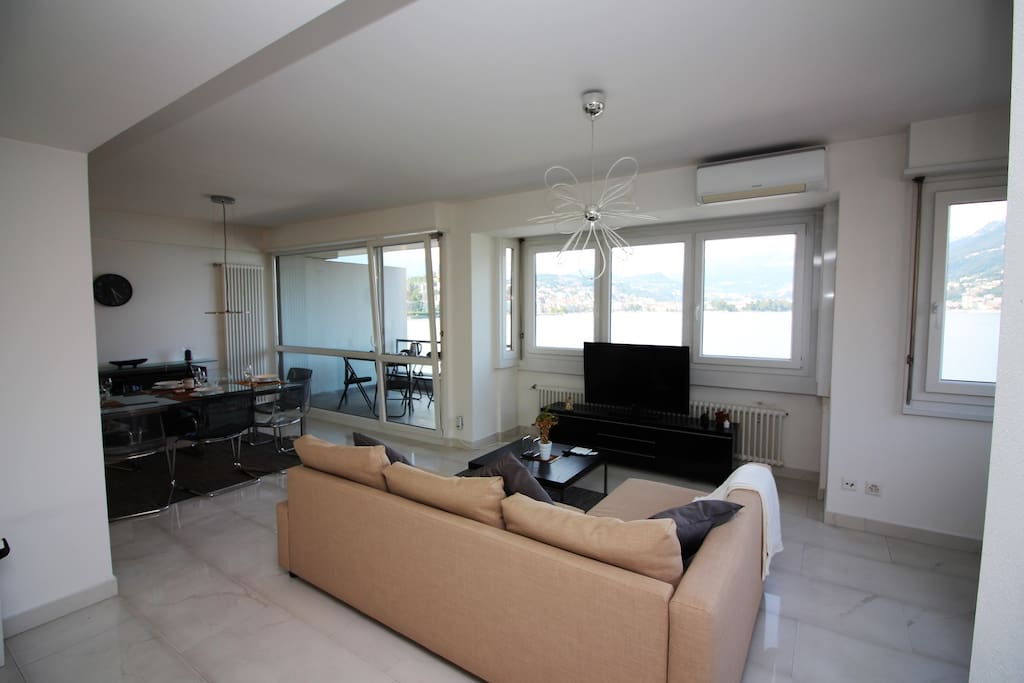 Living room with panoramic windows and access to the balcony