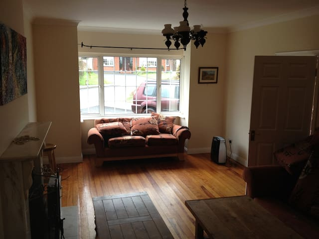 Large bright living room, there is also a separate study.