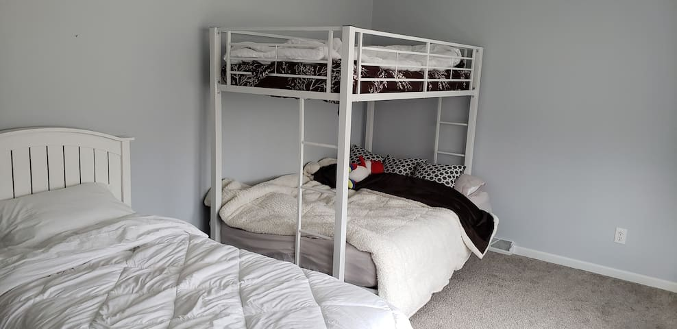 2nd bedroom with twin bed and bunk beds (twin and full futon).  Upper bunk can support an adult up to 250 lbs.