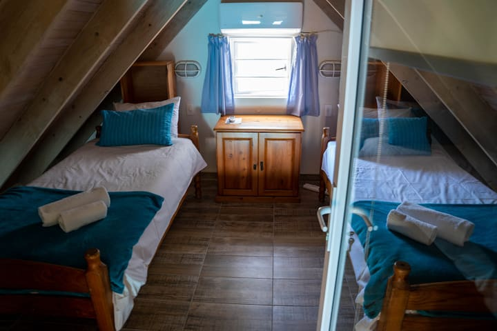 The loft room, a snug little place to hide away and read a book!  It's air-conditioned as well, so you will be comfortable!