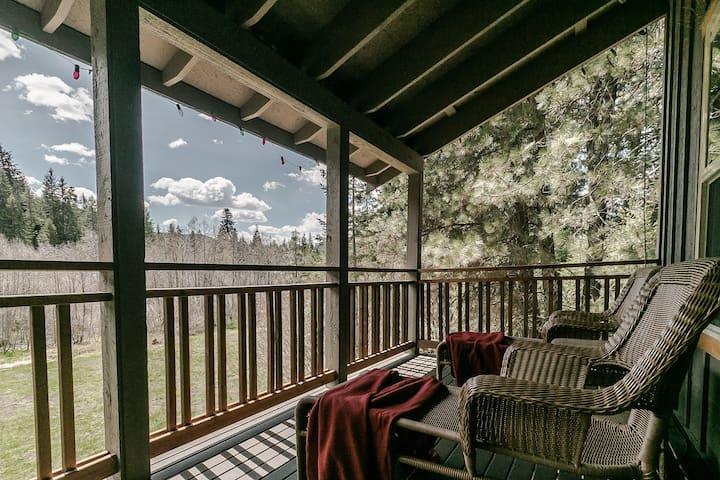 The upper deck overlooks the meadow and pines