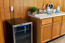 Beverage center in kitchen and additional counter area.
