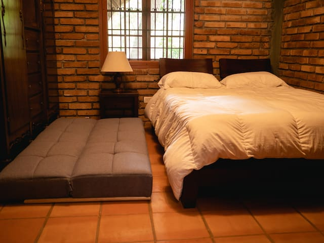 Secondary bedroom with a Private Bathroom, Queen Bed, A/C and a Sofa Bed if needed.