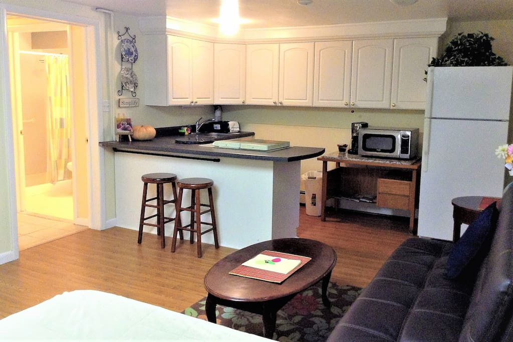 Full eat-in kitchen has refrigerator, micro oven, pots & dishes, silverware etc..