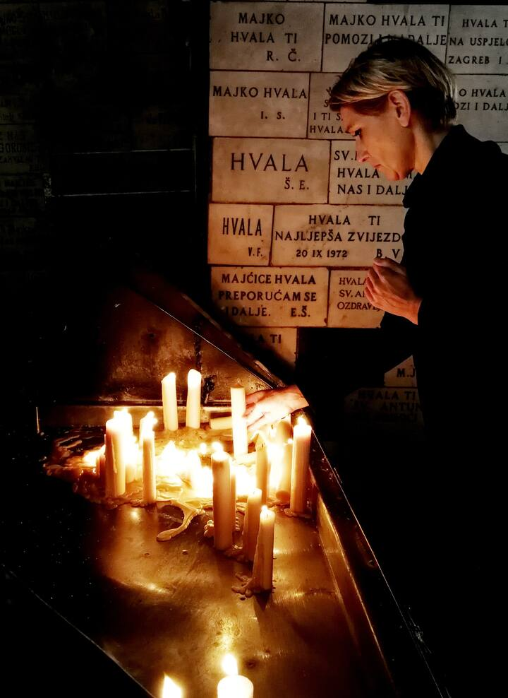 Light a candle at Stone Gate