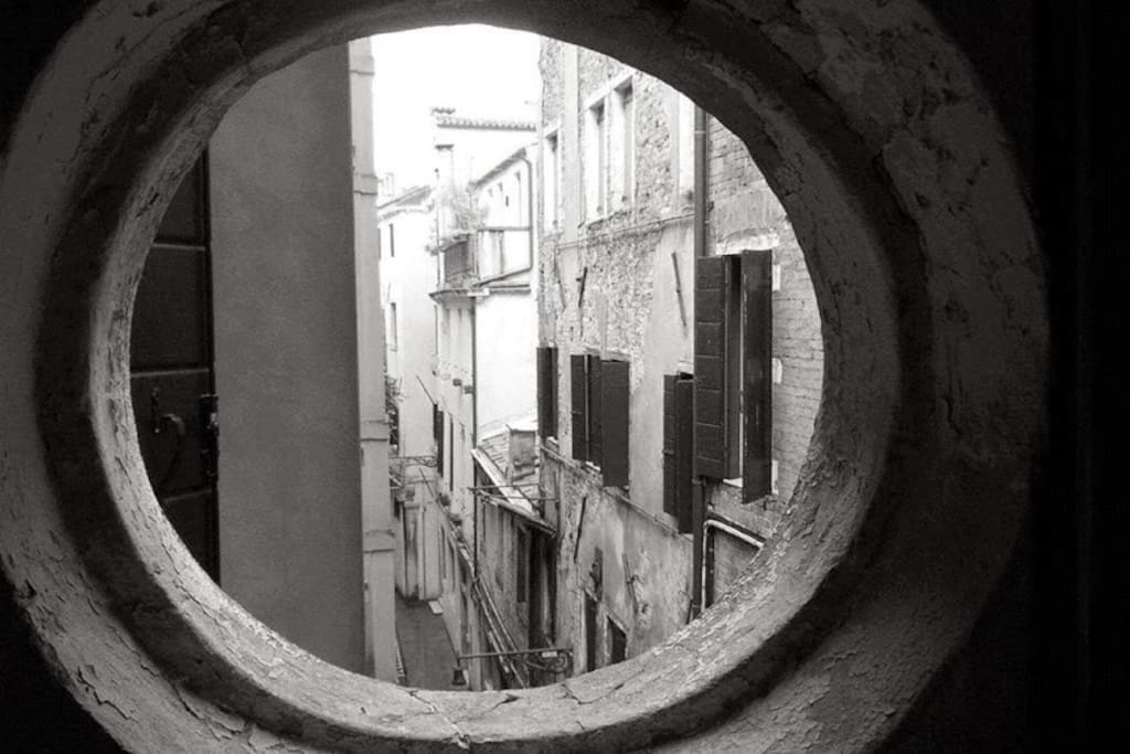 """View on a typical venetian street called """"Calle"""""""