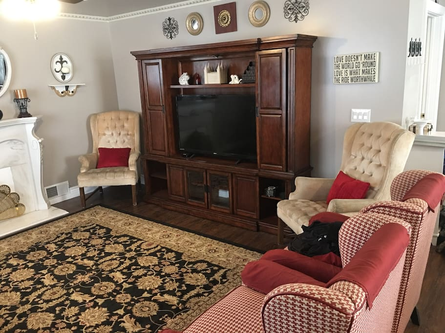 "Living Room with TV and Entertainment Center. 50"" LCD 1080p TV with HD antenna for local television channels and Apple TV for streaming. DirecTV Now streaming is provided. Other services use your own accounts"