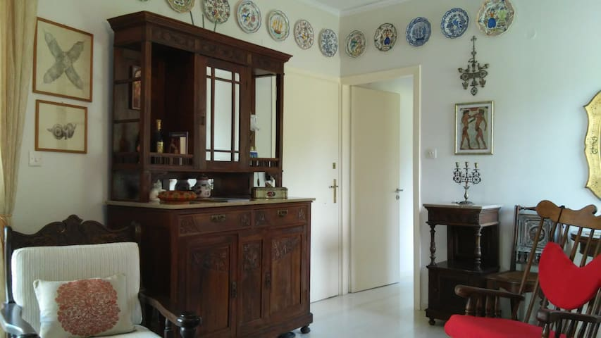 Part of the living room with beautiful antiques and folk art plates from the island of Skyros on the wall