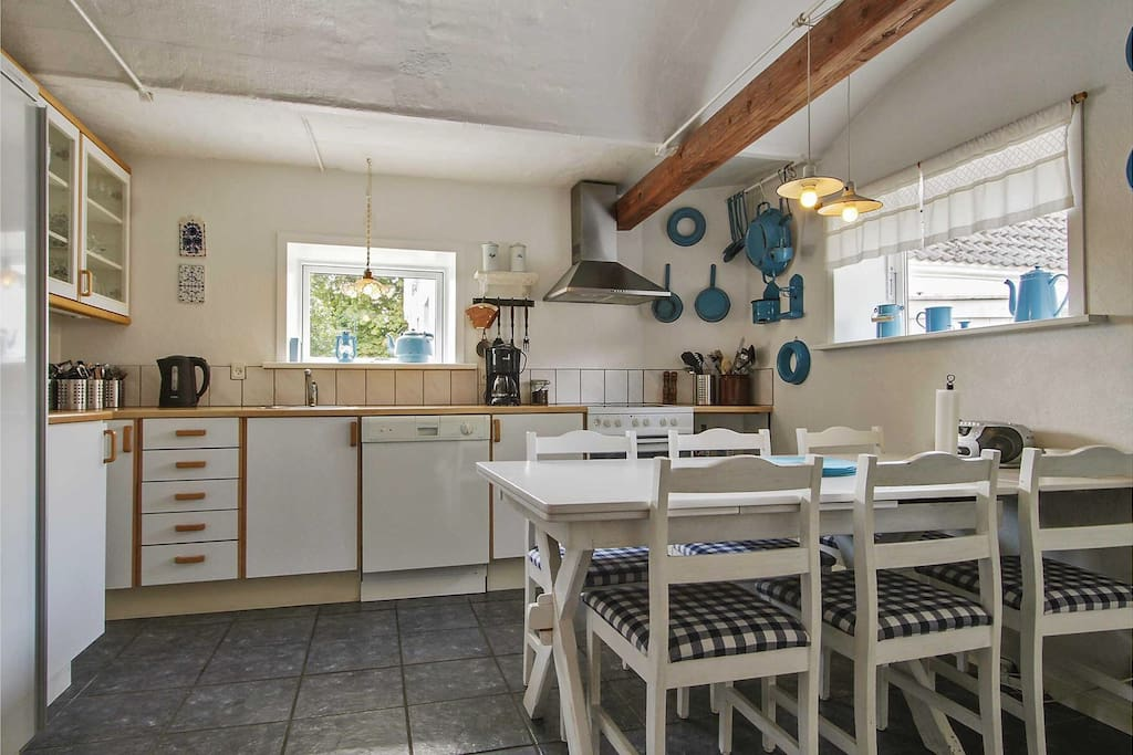 Shared fully equipped kitchen available to all guests, with coffee maker, dishwasher, microwave oven, fridge, stove top, oven etc