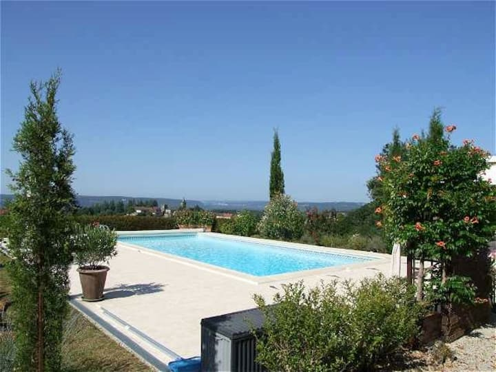 A tranquil poolside gite with stunning views