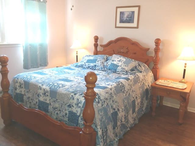 Master bedroom, queen size temperpedic bed,  your own TV,  ceiling fan and window air conditioner.