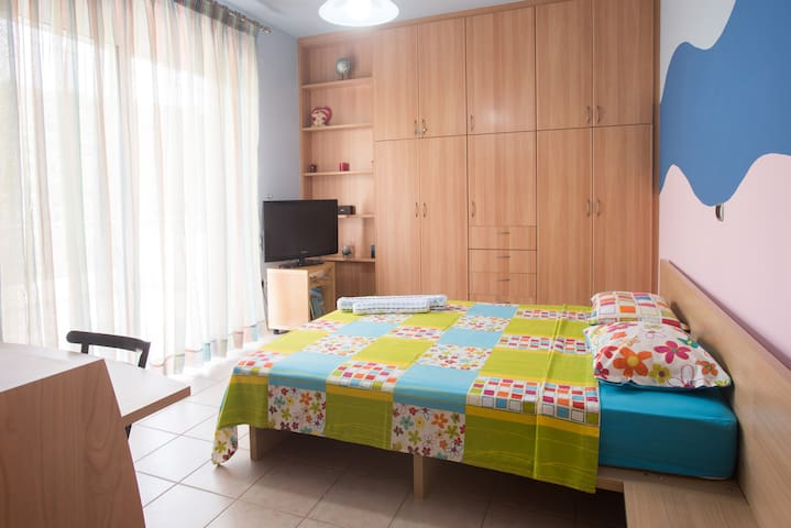 Bedroom on the 1st floor. Double bed,closet,  tv, desk area, air condition