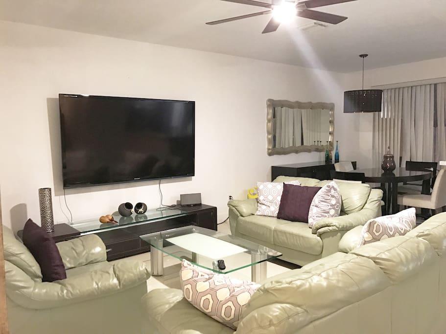 Living Room Area (ceiling fan & 80'inch tv)