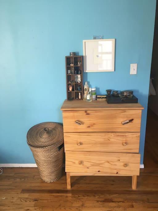 Three drawer dresser and laundry hamper.