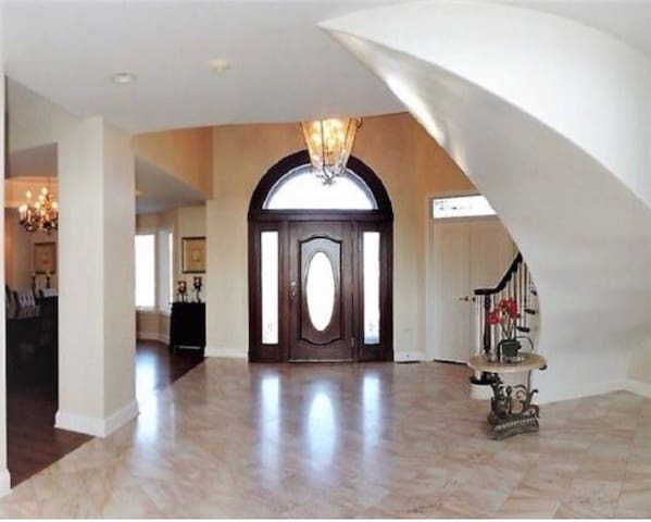 Grand entry way with sweeping staircase