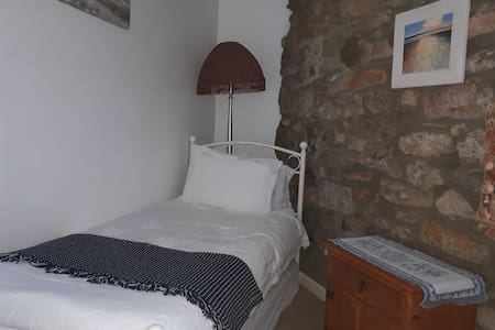 Unique single room with exposed stone wall