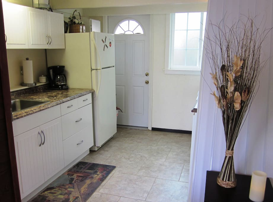 Well equipped kitchen includes dishes. cook ware, coffee pot & microwave.