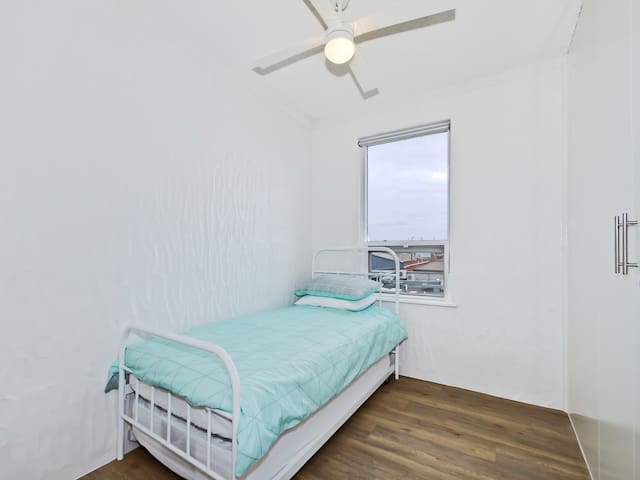 Single bed third bedroom with additional trundle bed.